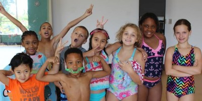 Kids smiling during school break camp at SwimRVA