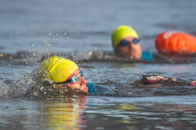 Two swimmers using the buddy system to safely swim in open water
