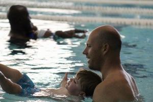 Parent and child in swim lessons