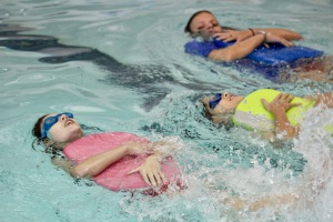 Swimmers practicing backstroke