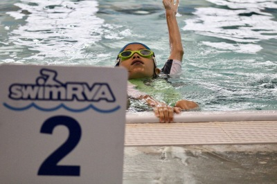Practicing back stroke at station 2 of SwimRVA Swim School