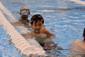 SwimRVA Swim School child giving thumbs up in the pool